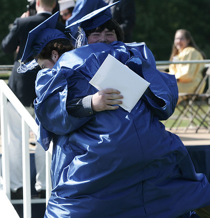Brendan Collins embraces his friend Patrick Conolly after receiving their diplomas at Danvers High School's graduation ceremony Saturday afternoon. Photo by Deborah Parker/June 6, 2009