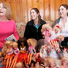 Ipswich: From left, Patty Pallazola of Ipswich and her two daugthers, Megan and Erin talk their large Barbie Collection that the girls played with when they were young. Photo by Deborah Parker/Salem News Friday March, 6, 2009.