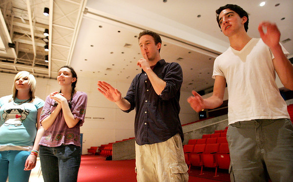 Alex Grover, director of Witch Pitch, an a cappella group at Salem High, leads a rehearsal Monday evening. Grover, who graduated from Salem High School in 2005 is now a graduate student at Boston University. The group will be having their first exclusive concert on Friday. From left, junior Renee Loughe, senior Anna Morsillo, Grover and junior Craig Simonetti.  Photo by Deborah Parker/May 24, 2010<br /> , Alex Grover, director of Witch Pitch, an a cappella group at Salem High, leads a rehearsal Monday evening. Grover, who graduated from Salem High School in 2005 is now a graduate student at Boston University. The group will be having their first exclusive concert on Friday. From left, junior Renee Loughe, senior Anna Morsillo, Grover and junior Craig Simonetti.  Photo by Deborah Parker/May 24, 2010