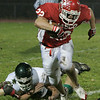 Boxford: Masconomet's Evan Bunker escapes the tackle during last night's game held at Masco. Photo by Deborah Parker/Salem News Friday, November 7, 2008.