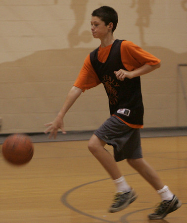 Patrick Gavin of Beverly dribbles the ball down the court during a youth basketball clinic at the Shore County Day School in Beverly Monday evening. Photo by Deborah Parker/October 4, 2010