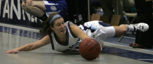 Peabody's Hayley Dowd tries her best to keep the ball in bounds during last night's Tanner City Holiday Classic against Wahconah Regional High School held at Peabody High School. Photo by Deborah Parker/December 29, 2009