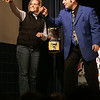 Beverly :Illusionist David Garrity has Centerville Elementary School second grade techer, Christine Mezza hold up her engagement ring that was used in an illusion during his show at the school Friday night. The show was used as an alternative to regular fundraising events such as selling cookies or gift wrapping. <br /> Photo by Deborah Parker/Salem News Friday, February 27, 2009