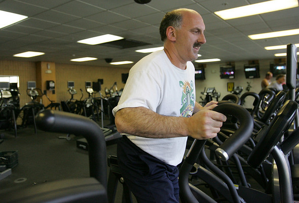 Jeff Calmus of Marblehead works out in the gym at the Jewish Community Center in Marblehead. The Center is finding it hard to compete to the new YMCA in town. Photo by Deborah Parker/October 30, 2009