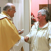 Father Herbert Jones is greeted by Evelyn Sutera of the Office of the Regional Bishop in Peabody following a celebratory mass at the St. Therese Carmelite Chapel-in-the-Mall. The Chapel is celebrating it's 50th anniversary of its dedication. Photo by Deborah Parker/January 28, 2010