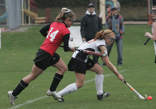 Beverly's Sam Jones is persued by Saugus' Jackie Doherty during Monday afternoon's game held in Beverly. Photo by deborah parker/october 25, 2010