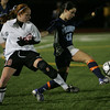 Peabody's Victoria Digiacomo fights to maintain control of the ball over Winchester's Hillary Savoy in yesterday's Division 1 North Semifinals held at Woburn High School. Photo by Deborah Parker/November 12, 2009