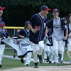 Bella Tracy, the dog of Matt Tracy, far left, runs with the team as they made a victory lap around Weafer Park in Woburn aftering defeating Stoneham in the little league sectional championship game Monday evening. This was Peabody West's five title. Photo by Deborah Parker/July 25, 2010