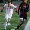 Lowell: Masco's Mark Evans fights for control of the ball against Mt. Greylock's Alvand Hajizadeh during Saturday's Division 2 State Championship soccer game in Lowell. Masco was defeated 3-2. Photo by Deborah Parker/Salem News Saturday, November 22, 2008.