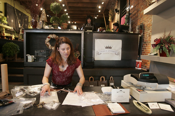 Kayley Biery, co-owner of Sweet Anthem in Salem works on organizing inventory while at the store Thursday afternoon. The store also shares the retail space with florist, Fiddlehead. Photo by deborah parker/december 2, 2010