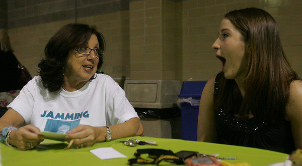 Marie Gauthier, mother of Julia Gauthier, a Salem teen killed in a car accident in March chats with Salem High senior Angelica Noble during a benefit concert at Salem State College Friday evening. THe concert was held to raise money for a scholarship fund established in Julia's honor. Photo by Deborah Parker/may 7, 2010