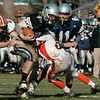 Hamilton: Hamilton-Wenham's Luke Drieze is brought down by Ipswich's Nathaniel Bocko during Thursday's Thanksgiving Day football game at Hamilton. Photo by Deborah Parker/Salem News Thursday, November 27, 2008.
