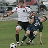 Salem: St. John's Prep's Dylan Stigliano and Salem's Brad Duhaime fight for control of the ball in yesterday's MIAA tournament action at Bertram Field. St. John's won the game 3-1. Photo by Deborah Parker/Salem News Friday, November 07, 2008