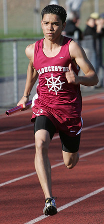 Gloucester's Guillermo Sierra competes in the 4 by 1 relay during yesterday's meet against Peabody held at Peabody High School. Photo by Deborah Parker/April 5, 2010