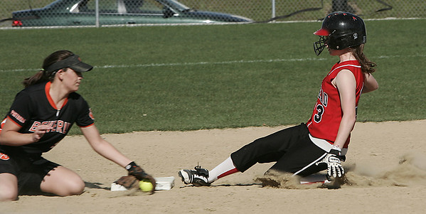 Marblehead's York ( no first names on roster)  is called safe after sliding into second against Beverly's Kiki McKenna during yesterday's game held in Beverly. Photo by Deborah Parker/May 21, 2009