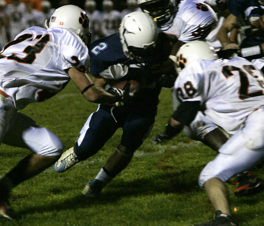 Peabody: Peabody's Mark D'Addario pushes his way through Beverly's defensive line during their game Friday night.<br /> Photo by Deborah Parker/Salem News Friday, October 10, 2008