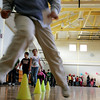 Sean LeTarte, jumping, a third grade student at the Captian Samuel Brown School, along with classmates walks aroung the gynasium as part of a school wide American Diabetes Association School Walk Thursday. Students from kindergarten to fifth grade participated in the event to raise awareness about diabetes. Photo by Deborah Parke/November 19, 2009