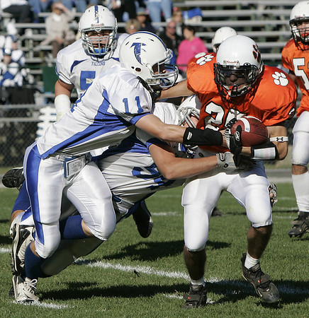 Beverly : Beverly's Curtis Manuel is brought down by Danvers' Steven Hennessey during Saturday's game at Hurd Stadium. Photo by Deborah Parker/Salem News Saturday, October 18, 2008