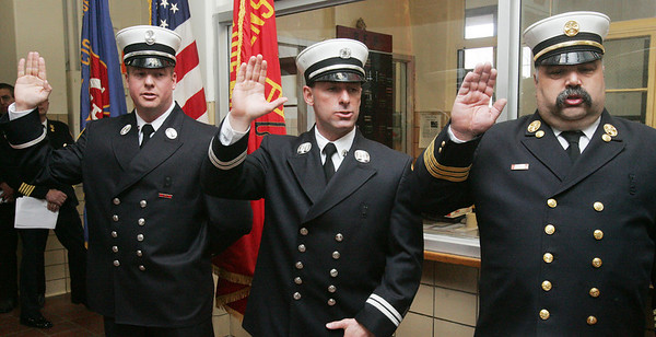 From left, newly promoted Leiutenant Matthew Kowalski, Captian Russell Halloran and Deputy Cheif Michael Acciavatti are sworn in during a ceremony at Beverly Fire Headquarters Tuesday afternoon. Photo by Deborah Parker/February 2, 2010