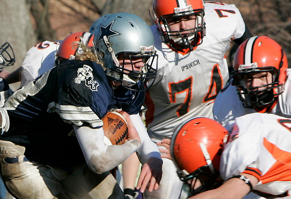 Hamilton: Hamilton-Wenham's Luke Drieze pushes his way through the Ipswich defensive line during Thursday's Thanksgiving Day football game at Hamilton. Photo by Deborah Parker/Salem News Thursday, November 27, 2008.