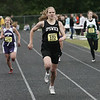 Ipswich's Hannah O'Flynn leads Vineyard's Kim Carlomagno and Duxbury's Julia Nee in the 400 meter dash to win the event during the Division 3 State Track Meet held at Ipswich High School Friday. Photo by Deborah Parker/May 29, 2009