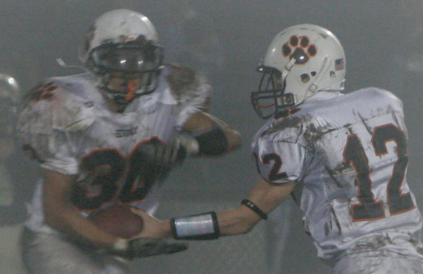 Winthrop: Beverly's Mark Hannable passes off the ball to Rashad Sims during during Friday night's game at Miller Field in Winthrop. Photo by Deborah Parker/Salem News Friday, Novemeber 14, 2008.
