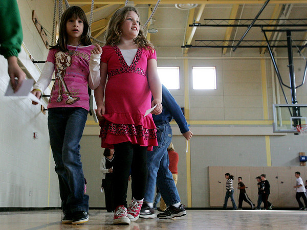 Adrianna White, left, and Abby Fitzgerald, both third graders at the Captian Samuel Brown School, walk aroun the gynasium as part of a school wide American Diabetes Association School Walk Thursday. Students from kindergarten to fifth grade participated in the event to raise awareness about diabetes. Photo by Deborah Parke/November 19, 2009