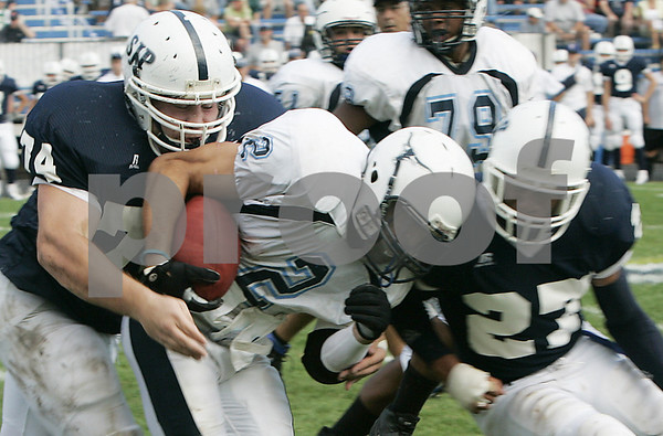 Danvers:Peabody's Mark D'Addario is sacked on either side by St. Johns' Andrew Valeri and George Sessoms during Saturday's game held at St. John's. <br /> Photo by Deborah Parker/Salem News Saturday, September 13, 2008