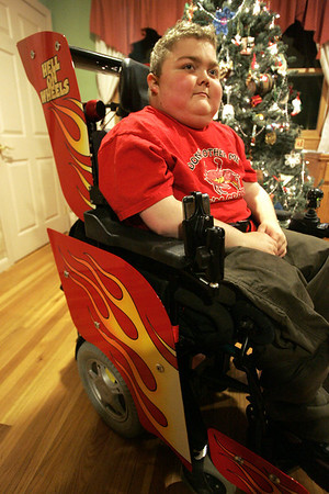 Recently a New Hampshire racing company, Dan Page Racing, worked to vamp up the wheelchair of 15-year-old Max Gaudenzi. His wheelchair now has speakers for his iPod, fire decals and even a skull  on the steering control. Photo by deborah parker/novemer 29, 2010