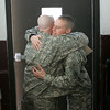 Sargeant Sean Ross, embraces Staff Sargeant Eric Collins before Collins boarded a bus to join the Massachusetts National Guard 101st Field Artillery Unit, based at the Danvers Armory, as they deployed today for training as they head to Afghanistan. Photo by Deborah Parker/January 6, 2009.