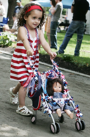 Gianna Stellato, 2, of Peabody shows off her carraige to the judges during Saturday's Doll Carriage Parade at Endicott as part of Endicott Park Day. Photo by Deborah Parker/June 20, 2009