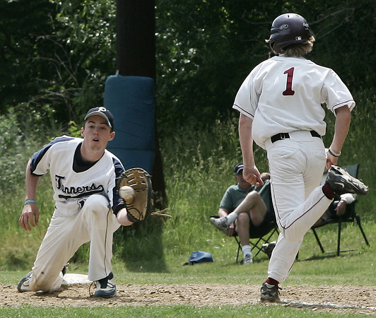 Peabody's Joe Gruntkosky makes the catch at first for the out against Lowell's Derek Reed during yesterday's Division 1 North Baseball playoff game held at Peabody's Veteran's Memorial High School. Photo by Deborah Parker/May 31, 2009