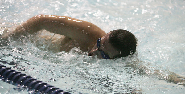 Conor Birningham of the St. John's swim team works through a drill at an early morning practice at the Danvers YMCA Wednesday morning. photo by deborah parker/decemeber  7, 2010