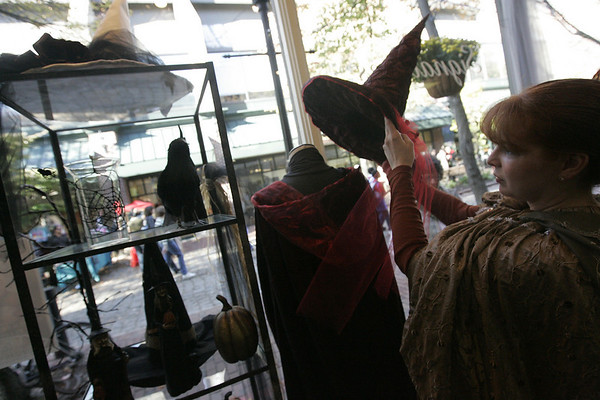 Salem: Jennifer Stavros, co-owner of Signatures clothing store arranges some items in their Halloween styled window display. Photo by Deborah Parker/Salem News Friday, October 10, 2008
