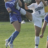 Danvers' Corey Persson and Peabody's Cayla Bucci make contract while trying to gain control of the ball during Wedensday afternoon's game held in Peabody. Photo by Deborah parker/september 29, 2010
