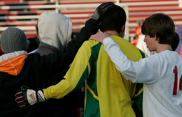 Lowell: Masco boy's soccer teammates comfort one another after the team's loss to Mt. Greylock during Saturday's Division 2 State Championship soccer game in Lowell. Masco was defeated 3-2. Photo by Deborah Parker/Salem News Saturday, November 22, 2008.