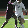 Danvers' Christopher Ciampa, fights for control of the ball against Concord-Carlisle's Will Toczylowski during the Division 2 North Semifinals held at Woburn High School. Photo by Deborah Parker/November 13, 2009