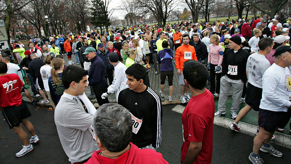 Runners wait for the start of the 6th Annual Wild Turkey 5 Mile Run on Thanksgiving Day at the Salem Common. Photo by Deborah Parker/NOvember 26, 2009