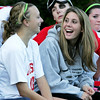 Injured player Lexi Dussi laughs with teammate Lucy Gildein on the sidelines during Tuesday's game at Masconomet against Manchester Essex. Lexi is going to one of the country's strongest Division 2 programs to continue her soccer career.  Photo by Deborah Parker/October 20, 2009