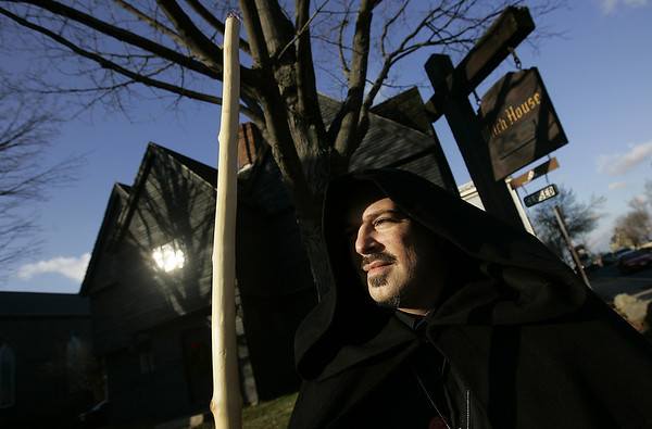 """Salem: Eric Fraize the """"Witch King of Salem"""", stands in front of the Witch House which recently turned down a request from Spirit Finders Paranormal Investigatros of Rhode Island to conduct a scientific investigation inside the Witch House. Fraize, represented the organization before the Park and Recreation Comission and would have participated in the investigation. Photo by Deborah Parker/Salem News Thursday, December 18, 2008"""