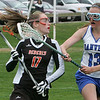 Beverly's Hannah Moffie is defended by Danvers' Katie McKenna during yesterday's game held at Danvers High School. Photo by Deborah Parker/April 27, 2010