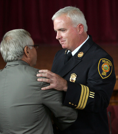 Joseph Daly is congratulated by Mayor Michael Bonfanti after being named the fire department's new deputy chief during a ceremony held at Peabody City Hall Wednesday morning. Photo by Deborah Parker/July 7, 2010