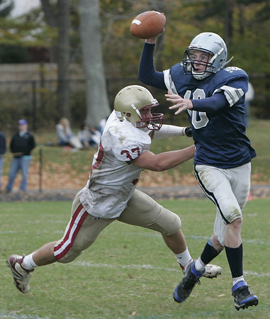 Hamilton:**(There was no roster)** Hamilton's Andy Duval passes the ball just before being tackled by Newburyport's #37 during yesterday's game at Hamilton. Newburyport defeated Hamilton 28-14.<br /> Photo by Deborah Parker/Salem News Saturday, October 25, 2008