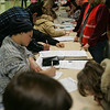 People sign paperwork before receiving the H1N1 vacination at Salem High School Wednesday evening. The clinic was held for children 18 months to 18 and was also available for pregnant women and caretakers of babies. Photo by Deborah Parker/December 9, 2009