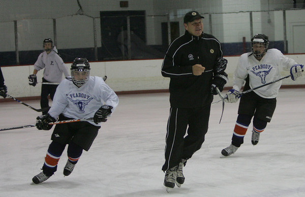 Bruins Alumni Tommy Songin leads a hockey clinic for squirt and peewee aged Peabody hockey players yesterday at McVann-Okeefe Rink. photo by deborah parker/