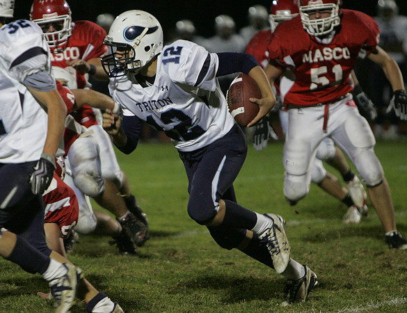 Triton's Blaise Whitman runs through Masconomet's defense during Friday night's game at Masconomet. Photo by Deborah Parker/October 23, 2009