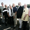 From left, Norm Dobson of Peabody, Joe Cole of Salem, Tony Garro of Salem, Gerry Boutin of Peabody, Bert Russell of Danvers, Mike Chouinard of Dracut, Paul Kelly of Lynn and Howard Morong of Wenham, pose for a picture before surprising Bert Russell with a honorary diploma from Beverly High School, 50 years after he left school early to serve in the Korean War.