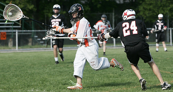 Beverly: Beverly's Kevin Ranta is pursued upfield by Marblehead's Adam Wassaf during yesterday's game held at Hurd Stadium. Photo by Deborah Parker/May 15, 2009
