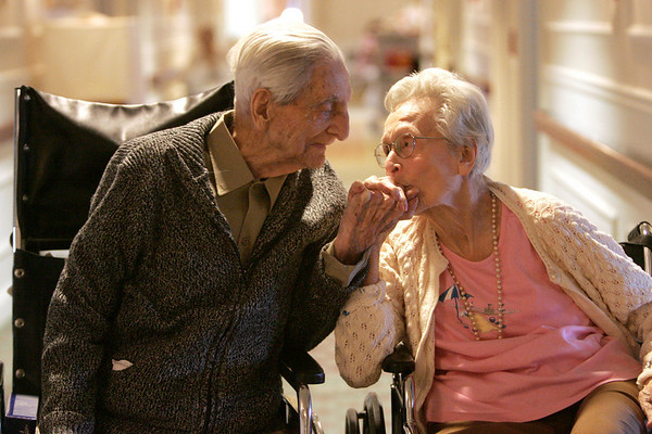 Marie LeBlanc gives her husband of 71 years, Gerard, a kiss on the hand while at Grosvenor Park Nursing Center in Salem Thursday. The two celebrated their 71rst wedding anniversary on Decemebr 2. Photo by deborah parker/december 2, 2010