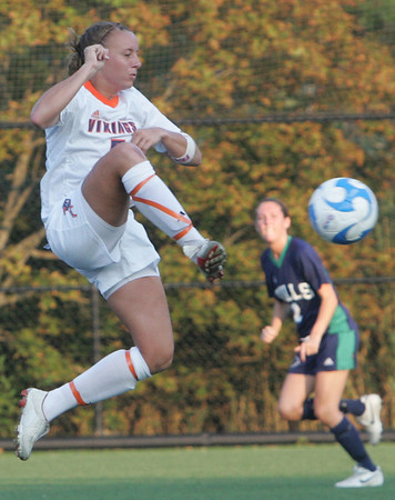 Salem State's Taylor Orlando moves the ball back up the field during yesterday's game against Endicott held at Salem State University in Salem. Photo by Deborah Parker/September 1, 2010